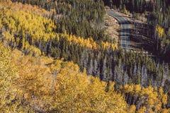 Highway at autumn in Colorado, USA. Highway at autumn sunny day in Rocky Mountain National Park. Colorado, USA Stock Photos