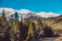 Highway at autumn in Colorado, USA. Highway at autumn sunny day in Rocky Mountain National Park. Colorado, USA Royalty Free Stock Photo