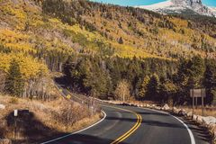 Highway at autumn in Colorado, USA. Royalty Free Stock Image