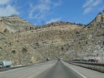 Highway through barren canyon Royalty Free Stock Photos