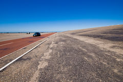 Highway in barren landscape Royalty Free Stock Photo