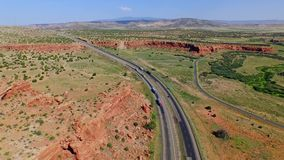 Highway in a beautiful canyon plain valley stock footage