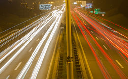Highway in Belgrade 1. Driving on highway at night Belgrade - Serbia. Light trails on motorway at night of full moon, long exposure abstract photograph royalty free stock image