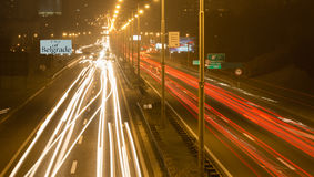 Highway in Belgrade 2. Driving on highway at night Belgrade - Serbia. Light trails on motorway at night of full moon, long exposure abstract photograph stock photos