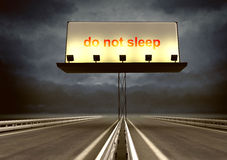 Highway with billboard and dark evening sky and text Stock Photography