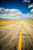 Highway and blue sky. Vibrant image of highway and blue sky Stock Image