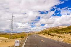 Highway with blue sky. Mountain with blue sky near Shigatse city Royalty Free Stock Images