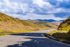 Highway with blue sky. Tibet Stock Photography