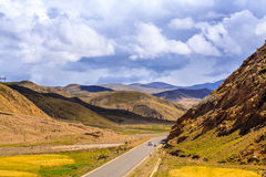 Highway with blue sky. Tibet Royalty Free Stock Photos