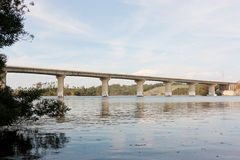 Highway Bridge across River against landscape Stock Photo