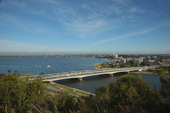 Highway bridge across water leads to an island - The Narrows Bridge in South Perth. South Perth skyline view from Kings Park. Australia Royalty Free Stock Photos
