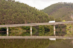 Highway Bridge against landscape with truck Royalty Free Stock Photo