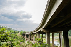 Highway bridge in cloudy spring sky Stock Images