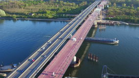 Highway bridge construction site - aerial view. Aerial view of large bridge construction site Schiersteiner Bruecke - A643, Germany. The highway bridge connects stock footage