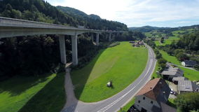 Highway on a bridge and motorway under the bridge. Aerial shoot of a highway road on the bridge and motorway road under the bridge stock video footage
