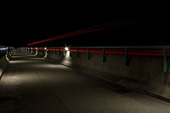 Highway bridge at night. Bridge at night with traffic light streaks from long exposure Royalty Free Stock Images