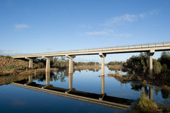 Highway bridge outback Western Australia. Highway bridge over Murchison River in Western Australia, with lush outback vegetation along the river bank and blue Royalty Free Stock Images