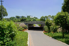 Highway bridge over countryside road in sunny summer Royalty Free Stock Images