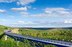 Highway bridge over extremadura forest in landscape. Sunny summer day Royalty Free Stock Photos