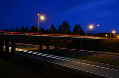 Highway. Bridge over the highway at night Royalty Free Stock Images