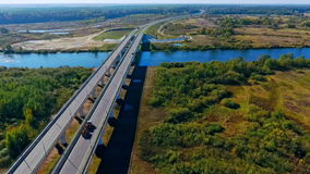 Highway bridge over river. Aerial view of bridge construction over river stock video