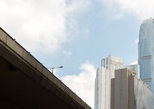Highway bridge with street light and business skyscrappers with blue sky. Highway bridge with street light and business skyscrappers with cloud and blue sky Royalty Free Stock Photos