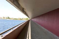 Highway bridge underpass path. By the sea Royalty Free Stock Photography
