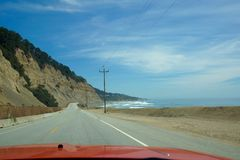 Highway 1 California. A car driving down highway 1 in California Royalty Free Stock Photo
