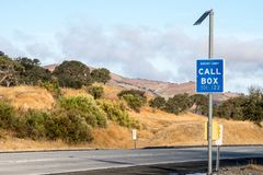 A highway call box along a rural roadside serves to help drivers in trouble. A highway call box along a rural roadside serves to help drivers in an emergency royalty free stock photos