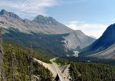 Highway through the Canadian Rockies. View of highway through the Canadian Rockies in the Kootenays near the British Columbia Alberta border. Highway winds its Stock Photography