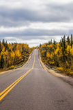 Highway. Canadian two lane highway with fall colors Royalty Free Stock Images
