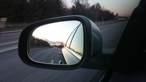Highway. Car mirror Volvo V70 Royalty Free Stock Photo