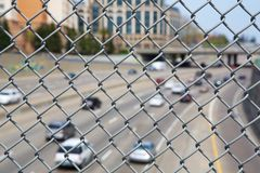 Highway Chain link fence up close Stock Photo