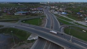 Highway with a circular intersection at which the traffic flow is going stock video footage