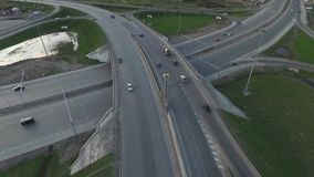 Highway with a circular intersection at which the traffic flow is going stock footage