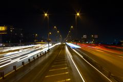 Highway through city at night. Busy light trail traffic on a freeway of Istanbul Royalty Free Stock Photo