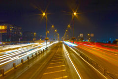 Highway through city at night. Busy light trail traffic on a freeway of Istanbul Royalty Free Stock Photos