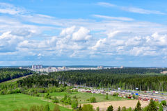 Highway and city in northern forest in summer Stock Photography