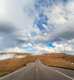 Highway into the clouds Royalty Free Stock Photos
