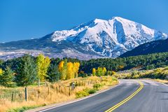 Highway at autumn in Colorado, USA. Highway in Colorado at autumn, USA. Mount Sopris landscape stock photography