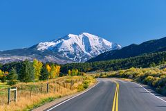 Highway at autumn in Colorado, USA. Highway in Colorado at autumn, USA. Mount Sopris landscape royalty free stock images