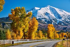 Highway in Colorado Rocky Mountains at autumn. USA. Mount Sopris landscape stock images