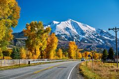 Highway in Colorado Rocky Mountains at autumn. USA. Mount Sopris landscape royalty free stock photos
