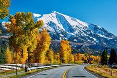 Highway in Colorado Rocky Mountains at autumn. USA. Mount Sopris landscape stock photos