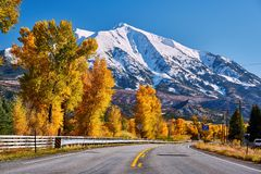 Highway in Colorado Rocky Mountains at autumn. USA. Mount Sopris landscape stock photo