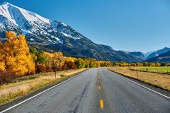 Highway at autumn in Colorado, USA. Highway in Colorado Rocky Mountains at autumn, USA. Mount Sopris landscape stock images
