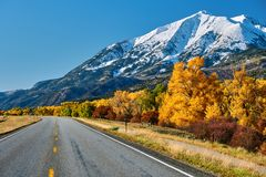 Highway at autumn in Colorado, USA. Highway in Colorado Rocky Mountains at autumn, USA. Mount Sopris landscape stock image