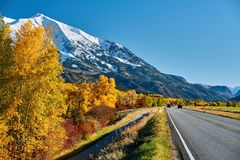 Highway at autumn in Colorado, USA. Highway in Colorado Rocky Mountains at autumn, USA. Mount Sopris landscape royalty free stock photo