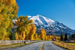 Highway in Colorado Rocky Mountains at autumn. USA. Mount Sopris landscape royalty free stock photo