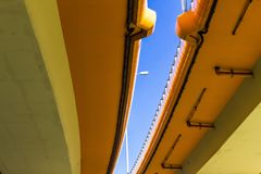 Highway and colored concrete overpasses. Blue sky and metal lantern in the gap. Modern technology in Warsaw, Poland royalty free stock image